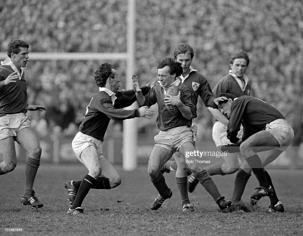 Keith Crossan of Ireland is held by Keith Robertson of Scotland during the Rugby Union International match held at Lansdowne Road, Dublin on 15th March 1986. Scotland beat Ireland 10-9. (Bob Thomas/Getty Images).