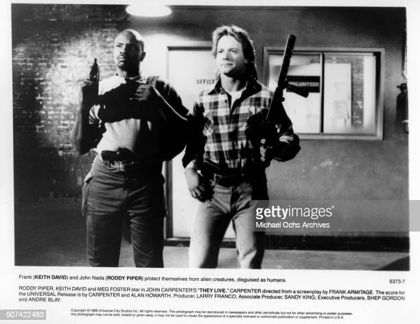 Keith David and Roddy Piper protest themselves from Alien creatures disguised as humans in a scene from the Universal Studio movie 'They Live' circa...