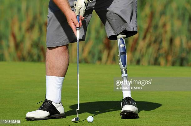Keith Dolman putts on the 10th green during the Disabled British Open golf tournament at East Sussex National golf course near Uckfield on September...