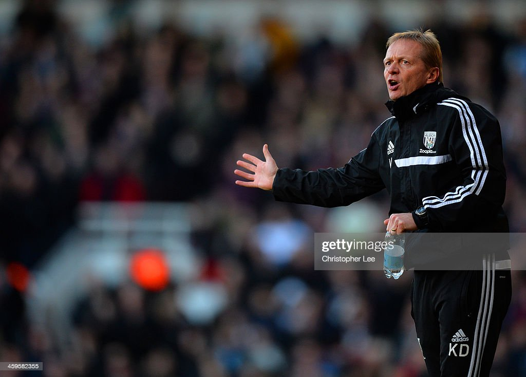 Keith Downing the West Bromwich caretaker manager gestutres during the Barclays Premier League match between West Ham United and West Bromwich Albion at Boleyn Ground on December 28, 2013 in London, England.