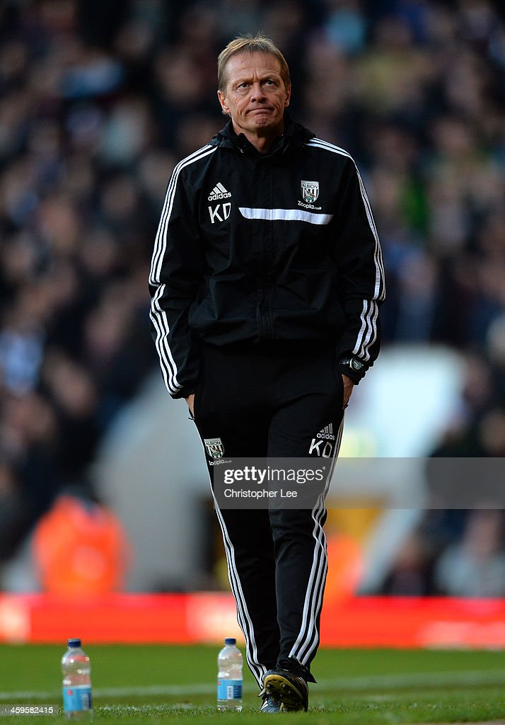 Keith Downing the West Bromwich caretaker manager looks on during the Barclays Premier League match between West Ham United and West Bromwich Albion at Boleyn Ground on December 28, 2013 in London, England.