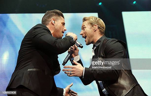 Keith Duffy and Ronan Keating of Boyzone perform on stage at O2 Arena on March 8 2011 in London United Kingdom