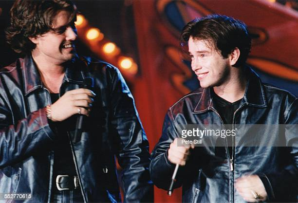 Keith Duffy and Stephen Gately of Boyzone perform on stage on the 'Smash Hits' tour at the National Exhibition Centre on October 24th 1996 in...