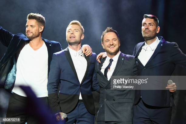 Keith Duffy Ronan Keating Mikey Graham and Shane Lynch from Boyzone perform at the Cheerios Childline Concert on November 20 2013 in Dublin Ireland