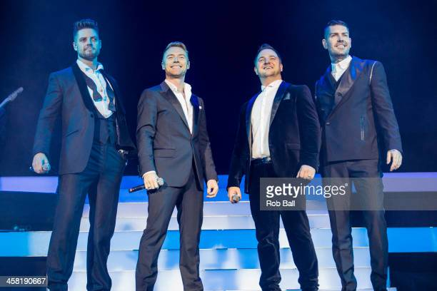 Keith Duffy Ronan Keating Mikey Graham and Shane Lynch of Boyzone performs at 02 Arena on December 20 2013 in London England