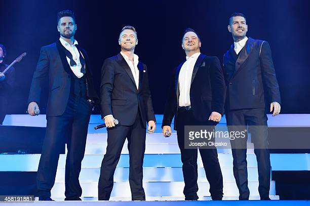 Keith Duffy Ronan Keating Mikey Graham and Shane Lynch of Boyzone performs on stage at the Boyzone 20th Anniversary Tour 2013 at O2 Arena on December...