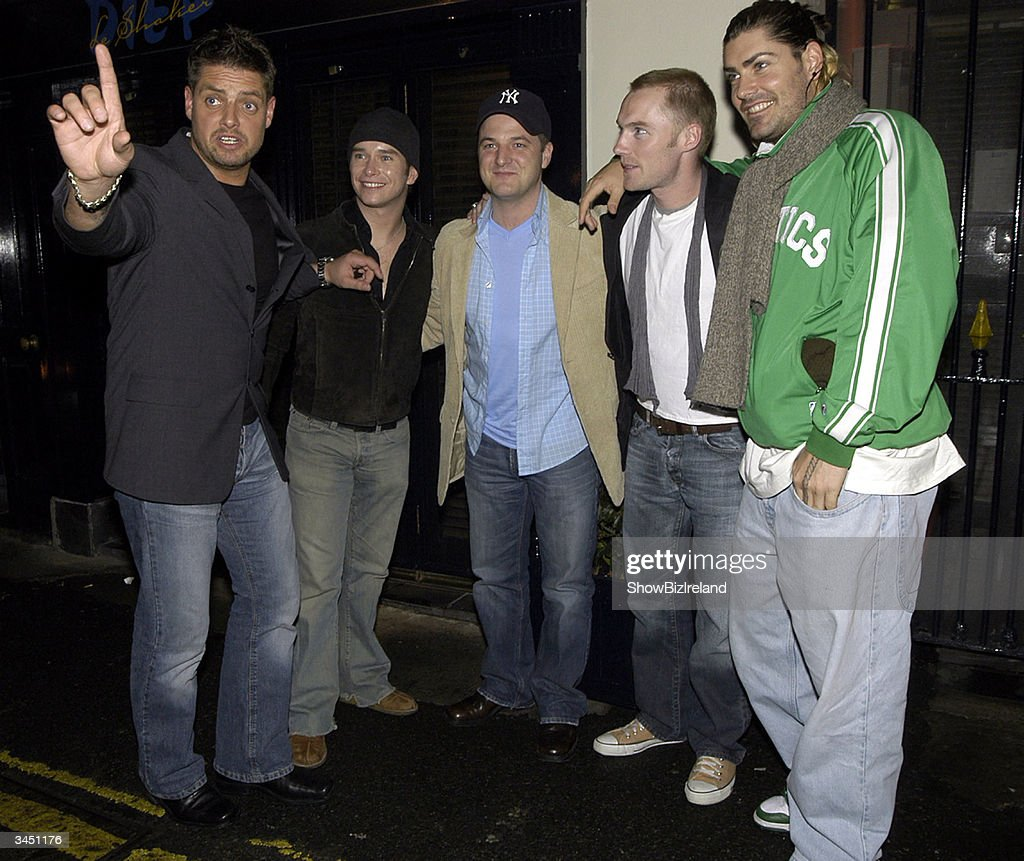 Keith Duffy, Stephen Gately, Mikey Graham, Ronan Keating and Shane Lynch, the former members of Boyzone, stand outside Diep Shaker Restaurant April 20, 2004 in Dublin, Ireland.