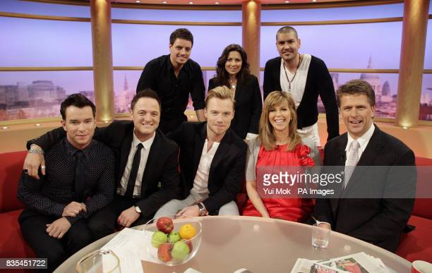 Keith Duffy weather presenter Clare Nasir and Shane Lynch with Stephen Gately Mikey Graham Ronan Keating Kate Garraway and Andrew Castle during GMTV...