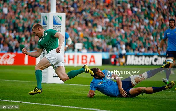Keith Earls of Ireland celebrates scoring their first try during the 2015 Rugby World Cup Pool D match between Ireland and Italy at the Olympic...