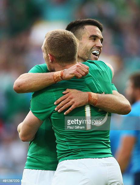 Keith Earls of Ireland celebrates scoring their first try with his team mate Conor Murray during the 2015 Rugby World Cup Pool D match between...