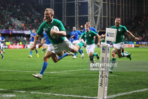 Keith Earls of Ireland jumps over the line to score their third try during the IRB Rugby World Cup Pool C match between Ireland and Italy at Dunedin...