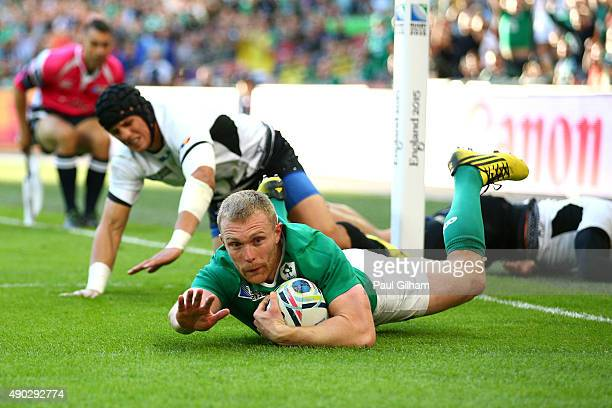Keith Earls of Ireland scores his teams second try during the 2015 Rugby World Cup Pool D match between Ireland and Romania at Wembley Stadium on...