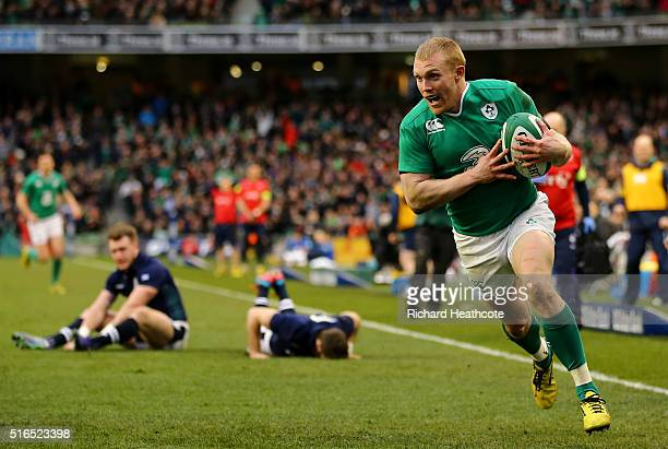 Keith Earls of Ireland scores his team's second try following a mix up between Stuart Hogg and Tommy Seymour of Scotland during the RBS Six Nations...