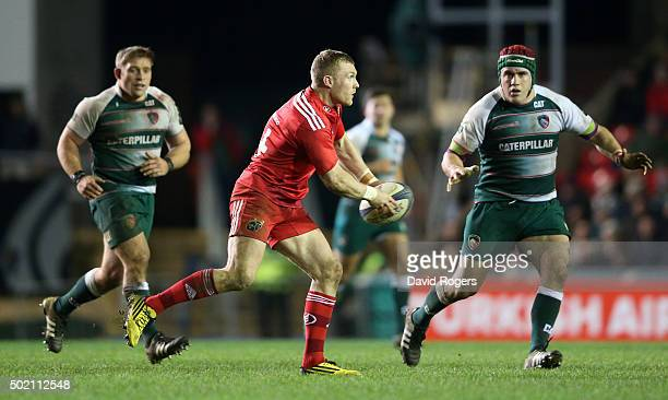 Keith Earls of Munster passes the ball during the European Rugby Champions Cup match between Leicester Tigers and Munster at Welford Road on December...