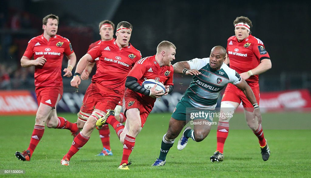 Keith Earls of Munster takes on Seremaia Bai during the European Rugby Champions Cup match between Munster and Leicester Tigers at Thomond Park on December 12, 2015 in Limerick, Ireland.