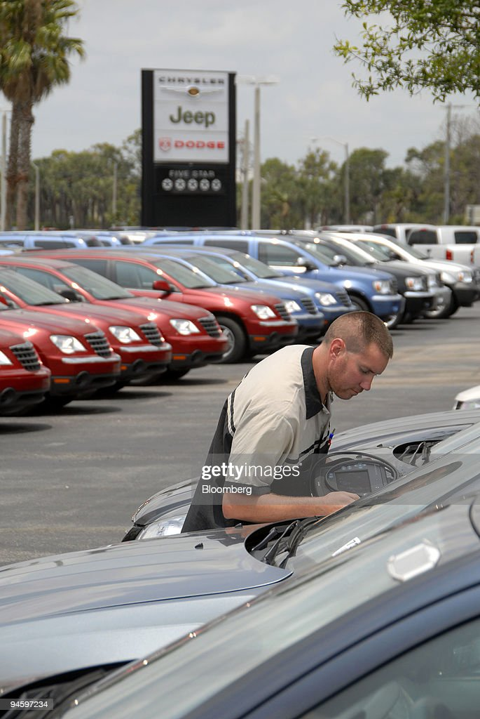Keith Edmondson A Service Technician At The Arrigo Chrysler Jeep Dodge  Dealership Prepares To Update Vehicle