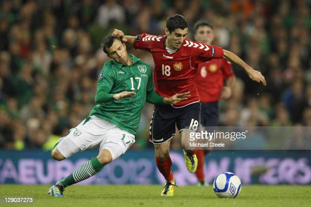 Keith Fahey of Republic of Ireland challenges Henrikh Mkhitaryan of Armenia during the EURO 2012 Group B qualifying match between the Republic of...