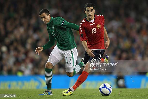 Keith Fahey of Republic of Ireland chases Henrikh Mkhitaryan of Armenia during the EURO 2012 Group B qualifying match between the Republic of Ireland...