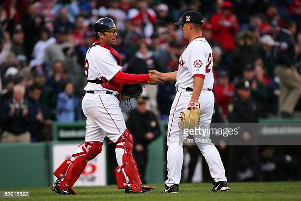 Keith Foulke and Doug Mirabelli of the Boston Red Sox celebrate after they defeated the New York Yankees at Fenway Park on April 11 2005 in Boston...