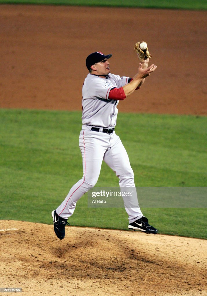 Keith Foulke #29 of the Boston Red Sox fields the ground ball of Edgar Renteria of the St. Louis Cardinals before throwing to first base for the final out in game four of the World Series on October 27, 2004 at Busch Stadium in St. Louis, Missouri. The Red Sox defeated the Cardinals 3-0 to win the World Series 4-0.
