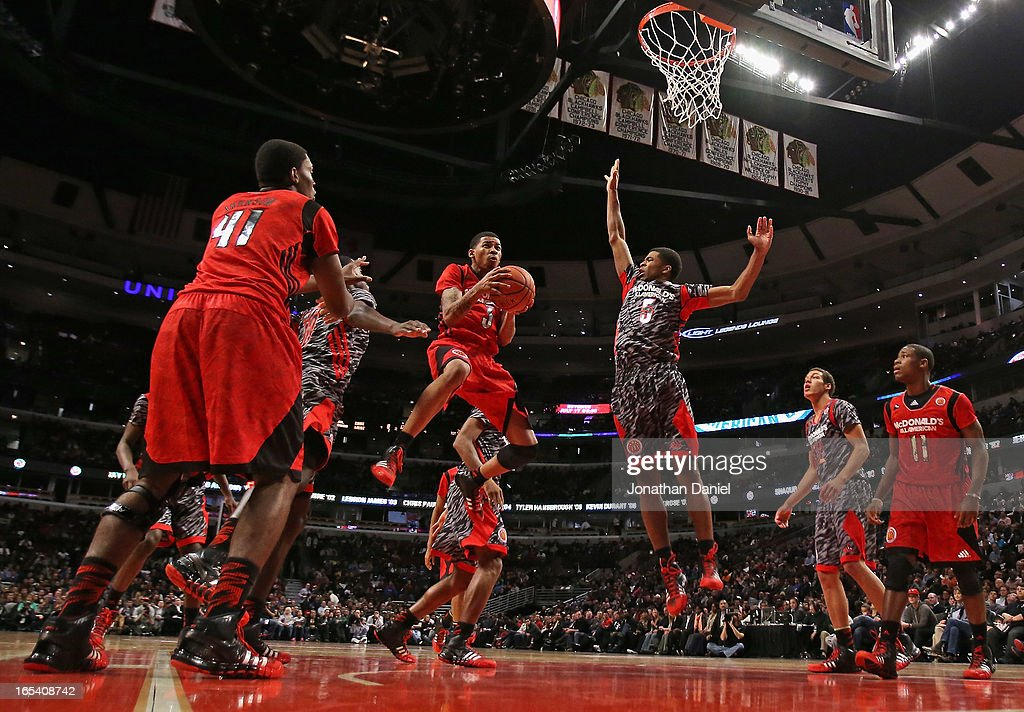 Keith Frazier #3 of the East drives to the basket past Andrew Harrison #5 of the West during the 2013 McDonald's All American game at United Center on April 3, 2013 in Chicago, Illinois. The West defeated the East 110-99.
