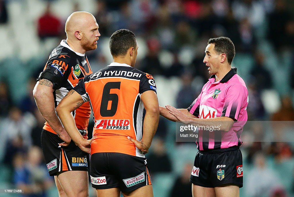 Keith Galloway (L) and Benji Marshall (C) of the Tigers speak to the referee after an altercation with Luke O'Donnell during the round 23 NRL match between the Wests Tigers and the Sydney Roosters at Allianz Stadium on August 19, 2013 in Sydney, Australia.