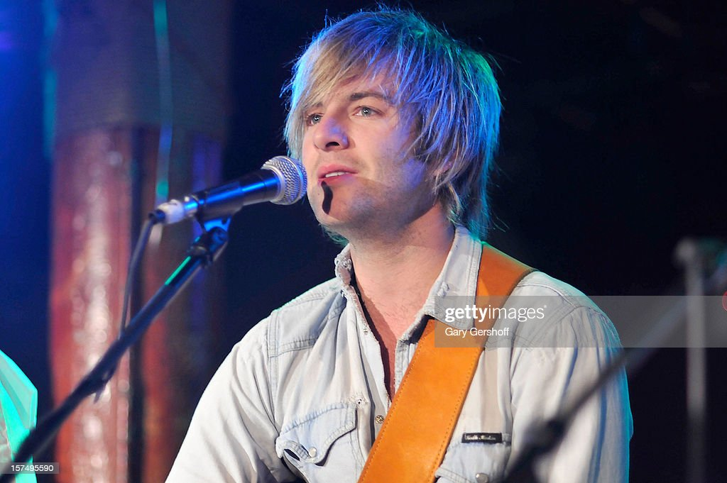Keith Harkin of Celtic Thunder performs during an unplugged concert benefitting Hurricane Sandy victims at Sullivan Hall on December 3, 2012 in New York City.