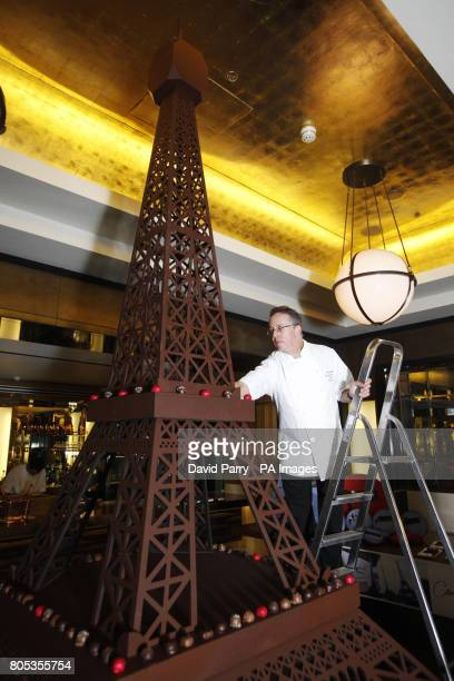Keith Hurdman Thorntons Master Chocolatier puts the finishing touches to a Thorntons chocolate Eiffel Tower at St Pancras Station to launch the...