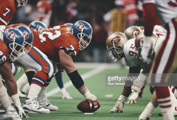 Keith Kartz Center for the Denver Broncos prepares to snap the ball against Michael Carter Nose Tackle for the San Francisco 49ers during the...