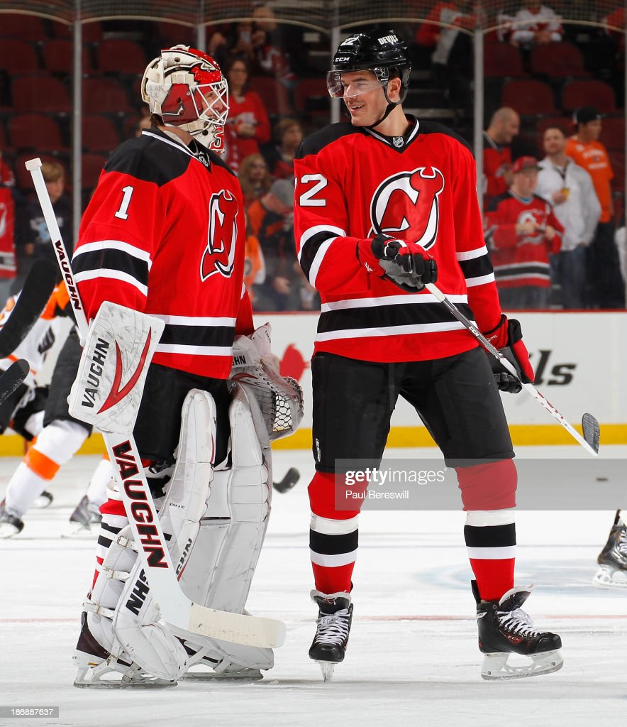 Keith Kinkaid #1 and Eric Gelinas #22 of the New Jersey Devils talk before a hockey game against the Philadelphia Flyers at Prudential Center on November 2, 2013 in Newark, New Jersey.