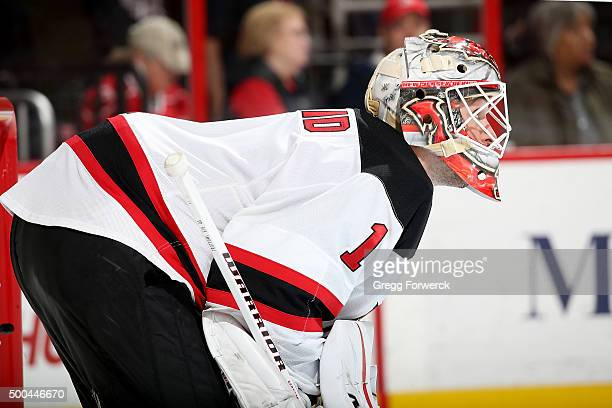 Keith Kinkaid of the New Jersey Devils crouches in the crease prior to a faceoff against the Carolina Hurricanes during a NHL game at PNC Arena on...