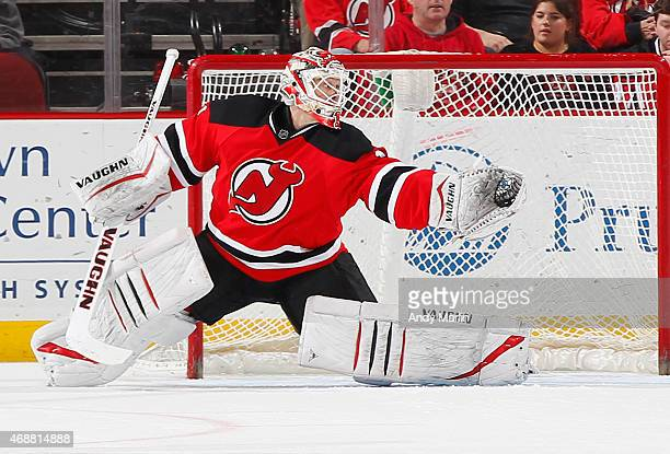 Keith Kinkaid of the New Jersey Devils defends his net against the Montreal Canadiens during the game at the Prudential Center on April 3 2015 in...