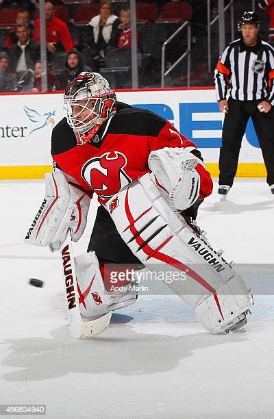 Keith Kinkaid of the New Jersey Devils defends his net against the Vancouver Canucks at the Prudential Center on November 8 2015 in Newark New Jersey