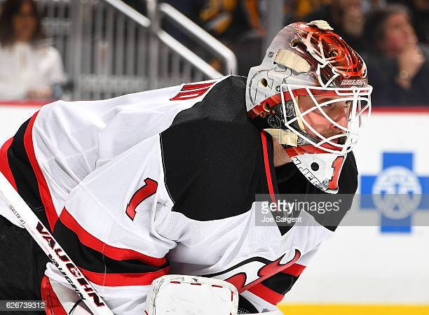 Keith Kinkaid of the New Jersey Devils defends the net against the Pittsburgh Penguins at PPG Paints Arena on November 26 2016 in Pittsburgh...