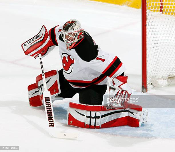 Keith Kinkaid of the New Jersey Devils guards the net during a NHL game at the SAP Center at San Jose on March 10 2016 in San Jose California