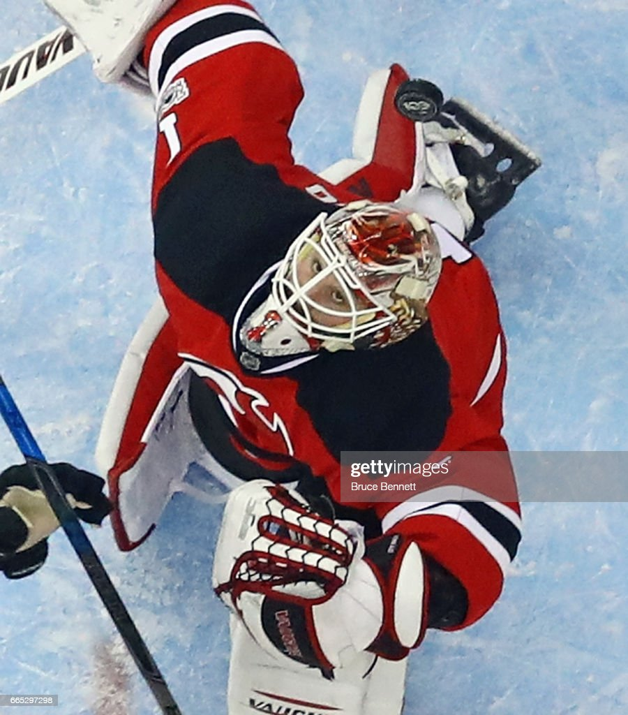 Keith Kinkaid #1 of the New Jersey Devils keeps his eyes on the puck against the Philadelphia Flyers at the Prudential Center on April 4, 2017 in Newark, New Jersey.