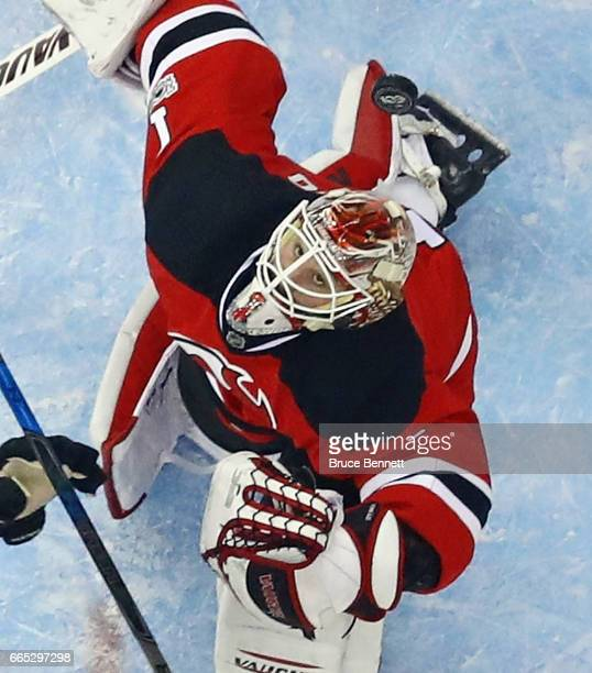 Keith Kinkaid of the New Jersey Devils keeps his eyes on the puck against the Philadelphia Flyers at the Prudential Center on April 4 2017 in Newark...