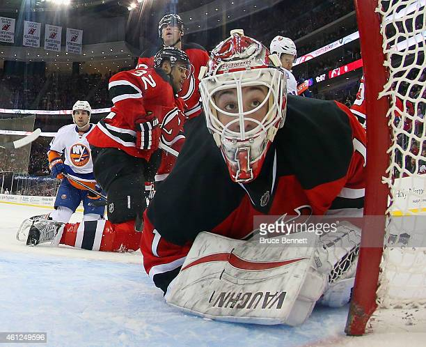 Keith Kinkaid of the New Jersey Devils looks back into the net during the second period against the New York Islanders at the Prudential Center on...