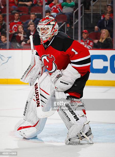 Keith Kinkaid of the New Jersey Devils looks on against the Montreal Canadiens during the game at the Prudential Center on April 3 2015 in Newark New...