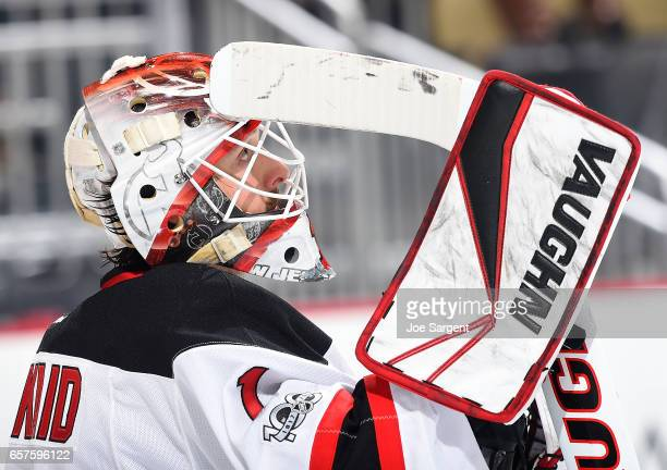 Keith Kinkaid of the New Jersey Devils looks on against the Pittsburgh Penguins at PPG Paints Arena on March 17 2017 in Pittsburgh Pennsylvania