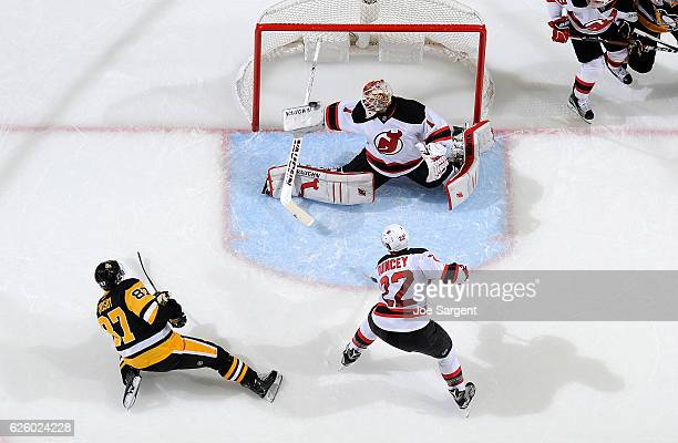 Keith Kinkaid of the New Jersey Devils makes a blocker save on Sidney Crosby of the Pittsburgh Penguins at PPG Paints Arena on November 26 2016 in...
