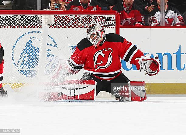 Keith Kinkaid of the New Jersey Devils makes a pad save against the Boston Bruins during the game at the Prudential Center on March 29 2016 in Newark...