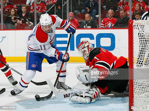 Keith Kinkaid of the New Jersey Devils makes a save against Brendan Gallagher of the Montreal Canadiens during the game at the Prudential Center on...