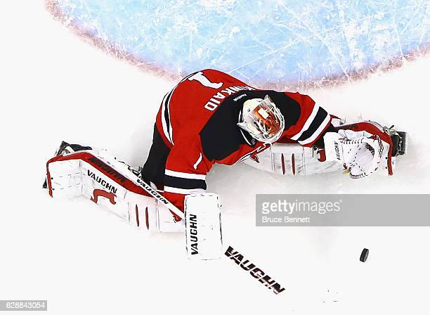Keith Kinkaid of the New Jersey Devils makes a save against the St Louis Blues at the Prudential Center on December 9 2016 in Newark New Jersey The...