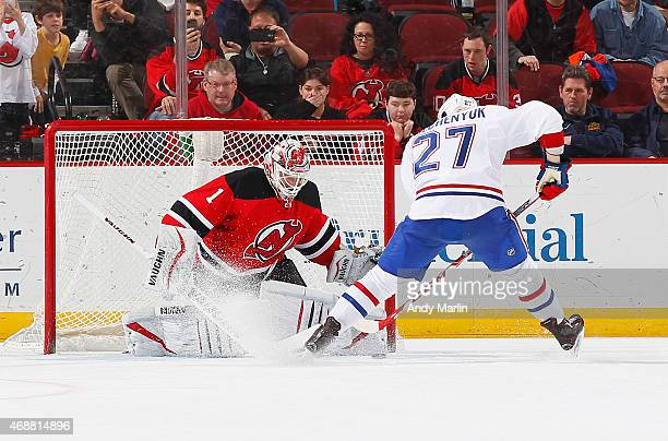 Keith Kinkaid of the New Jersey Devils makes a save in the shootout against Alex Galchenyuk the Montreal Canadiens during the game at the Prudential...