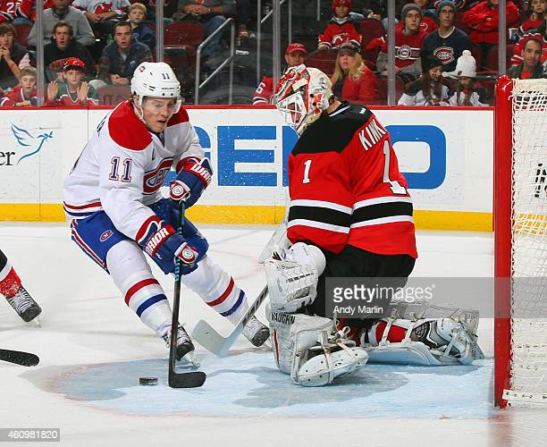 Keith Kinkaid of the New Jersey Devils makes a save on a closein shot by Brendan Gallagher of the Montreal Canadiens during the game at the...