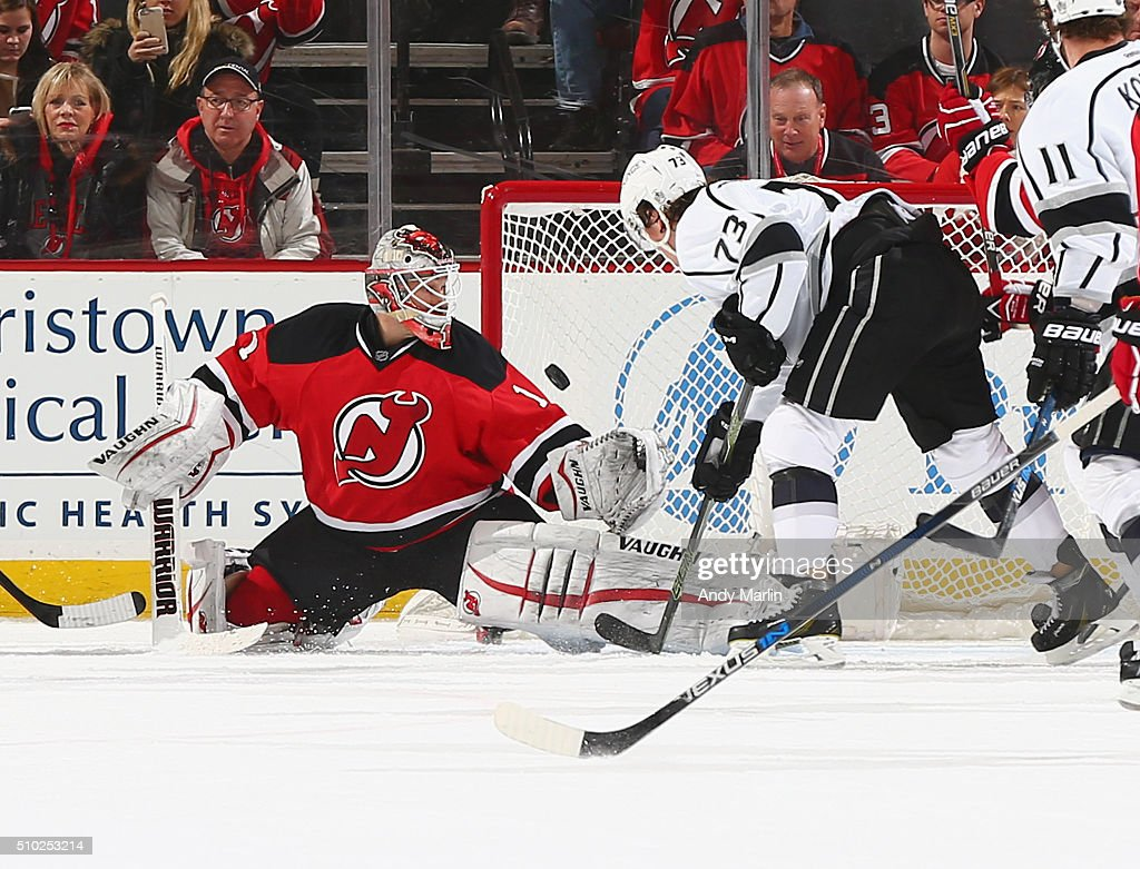 <a gi-track='captionPersonalityLinkClicked' href=/galleries/search?phrase=Keith+Kinkaid&family=editorial&specificpeople=7645382 ng-click='$event.stopPropagation()'>Keith Kinkaid</a> #1 of the New Jersey Devils makes a save on a shot by <a gi-track='captionPersonalityLinkClicked' href=/galleries/search?phrase=Tyler+Toffoli&family=editorial&specificpeople=6514151 ng-click='$event.stopPropagation()'>Tyler Toffoli</a> #73 of the Los Angeles Kings during the game at the Prudential Center on February 14, 2016 in Newark, New Jersey.