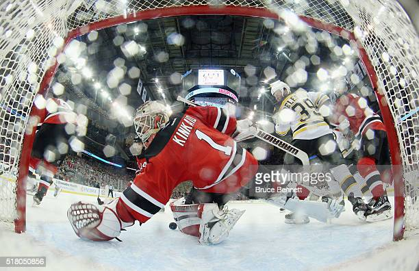 Keith Kinkaid of the New Jersey Devils makes the second period save against the Boston Bruins at the Prudential Center on March 29 2016 in Newark New...
