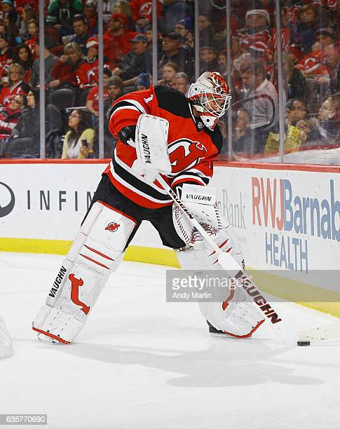 Keith Kinkaid of the New Jersey Devils plays the puck against the St Louis Blues during the game at Prudential Center on December 9 2016 in Newark...
