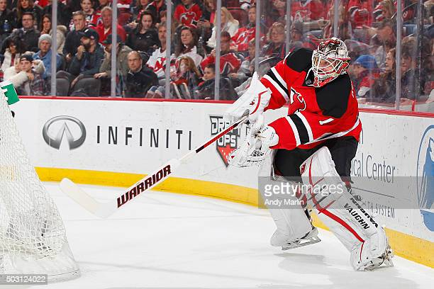 Keith Kinkaid of the New Jersey Devils plays the puck during the game against the Carolina Hurricanes at the Prudential Center on December 29 2015 in...